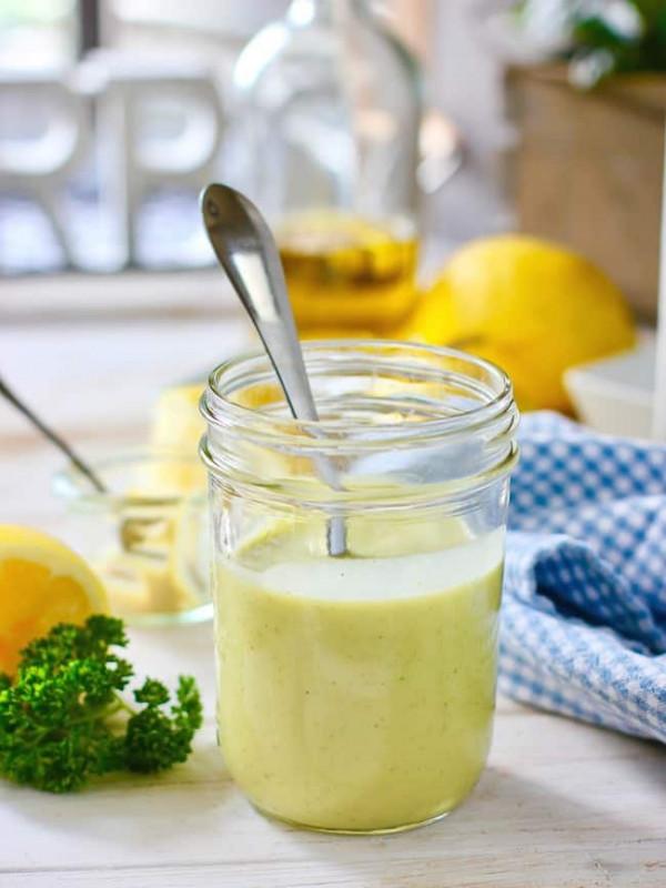 Lemon Dijon Vinaigrette in a mason jar with a spoon