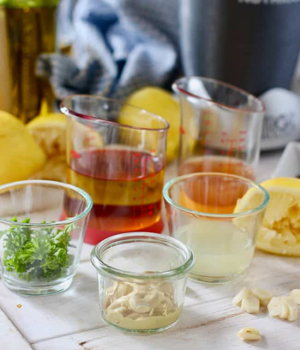 Dijon, lemon, oil and herbs all ready to make Lemon Dijon Vinaigrette